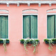 Three old windows with shutters — Stock Photo