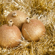 Three golden christmas baubles - 图库照片