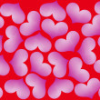 Purple hearts on red - Foto Stock