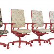 Royalty-Free Stock Photo: Four floral red office armchairs isolated