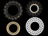 Four decorative vintage gold empty round picture frames — Stock Photo