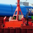 Stock Photo: Automatic spreader on background of deck cargo