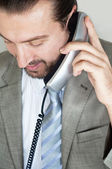 Businessmen talking on the phone — Stock Photo