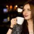 Beautiful young girl sipping coffee — Foto de Stock