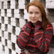 Outdoor portrait of beautiful redhair woman in red sweater — Stock Photo #4066265
