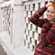 Outdoor portrait of beautiful redhair woman in red sweater — Stock Photo