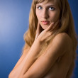 Portrait of beautiful nude woman with magnificent hair on blue b — Stock Photo
