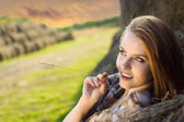 Young beauty woman daydreaming at farm — Stock Photo