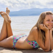 Stock Photo: Beautiful young woman relaxing near the sea