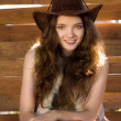 Stock Photo: Portrait of beautiful smiling cowgirl in stetson