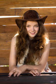 Portrait of beautiful smiling cowgirl in stetson — Stock Photo
