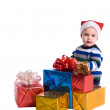 Pretty baby boy with many gifts isolated — Stock Photo