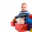 Pretty baby boy with gifts isolated — Stock Photo