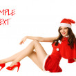Happy smiling woman in red xmas sexy costume isolated — Stockfoto