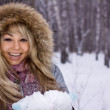 Young pretty smiling woman in winter forest - Stock Photo