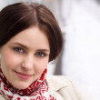 Young woman wearing winter clothes and smiling outdoors — Stock Photo