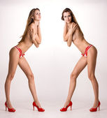 Beautiful woman in red shoes — Stock Photo