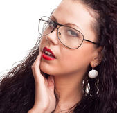 Portrait of a beautiful woman with curly hair isolated over whit — Stock Photo