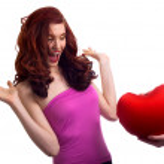 Boyfriend hands present surprice valentines heart to woman — Stock Photo #4756438