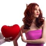 Boyfriend hands present surprice valentines heart to woman — Stock Photo #4756439