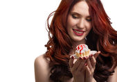 Beautiful happy woman with cake on the plate isolated on white b — Stock Photo