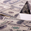 Pyramid on dollars. macro close-up — Stock Photo