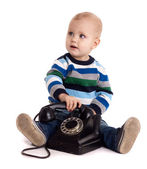 The baby boy with black vintage phone — Stock Photo