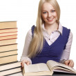 图库照片: Friendly College student girl with books at the desk isolated