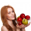 Young happy smiling woman with apple isolated on white — Stock Photo