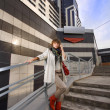 Stock Photo: Beauty casual womnear modern building