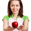Young happy smiling woman give red apple on plate isolated — Photo