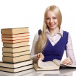 Friendly College student girl with books at the desk isolated — Stok fotoğraf
