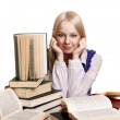 Friendly College student girl with books at the desk isolated — Foto de Stock