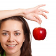 Stock Photo: Young happy smiling woman with apple isolated on white