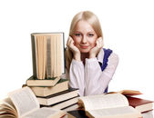 Friendly College student girl with books at the desk isolated — Stock Photo