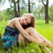 Beautiful teen girl in blue dress on the meadow — Stock Photo