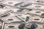 Background from chaotically lyings one hundred greenbacks — Stock Photo