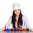 Young scientist at the table with test tubes on white background — Stock Photo