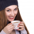 Happy young woman with cup of coffee on a white background — Stock Photo #5089105