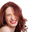 Stock Photo: Attractive smiling woman squint eyes on white background