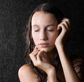 Portrait of pretty girl with close eyes in water studio — Stock Photo