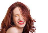 Attractive smiling woman squint eyes on white background — Stock Photo