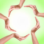 Woman's hands made circle on green background — Stock Photo