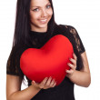 Woman holding Valentines Day heart sign with copy space — Stok fotoğraf