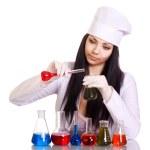 giovane scienziato al tavolo con provette su sfondo bianco — Foto Stock