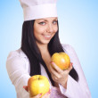 Healthy eating or lifestyle concept. Smiling woman doctor with a - Stockfoto