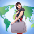 Stock Photo: Young stylish woman traveling on world map background