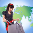 Young tourist woman with baggage on world map background — Stock Photo