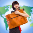 Stock Photo: Young tourist woman with baggage on world map background