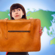 Young tourist woman with baggage on world map background — Stockfoto